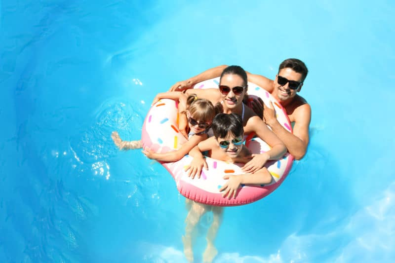 Family of four in pool