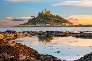 View of Mounts Bay and St Michael's Mount island in Cornwall at sunset
